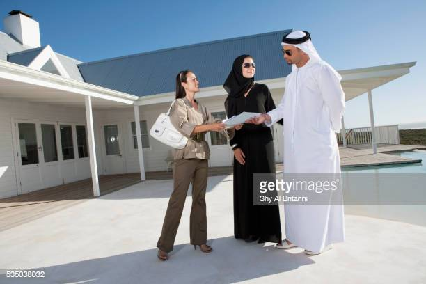 Couple receiving document from woman