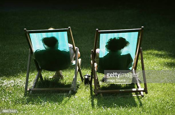 Couple reclining in deckchairs