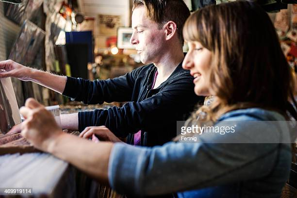 Couple record shopping in an old school store