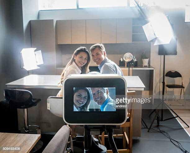 Couple recording a tv commercial