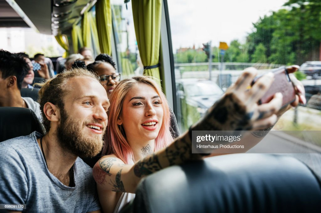 Couple Recording Their Journey Using Smartphone, Travelling On The Bus : Stock Photo