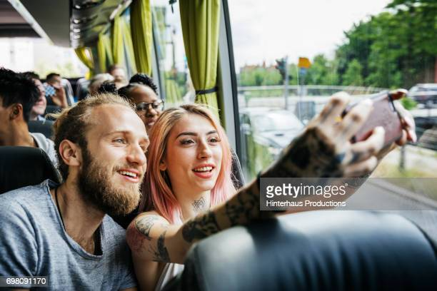 Couple Recording Their Journey Using Smartphone, Travelling On The Bus