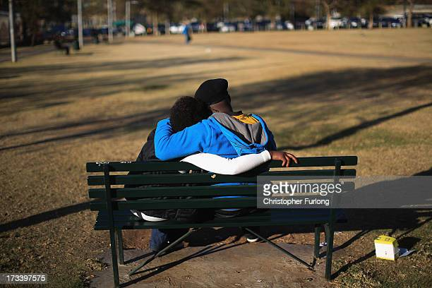 A couple relax in the afternoon sun as daily life continues as former president Nelson Mandela remains in critical condition on July 13 2013 in...