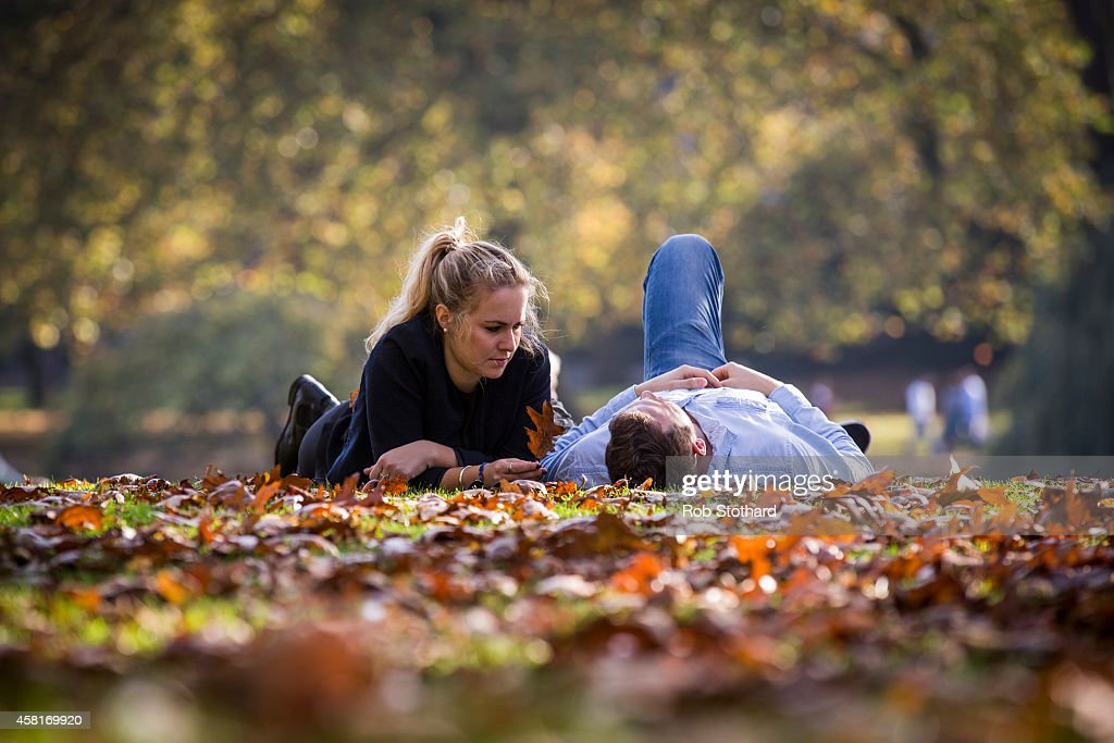 A couple relax in the sunshine in St James Park on October 31, 2014 in London, England. Temperatures in London are forecasted to exceed 20 degrees making today the hottest Halloween on record.