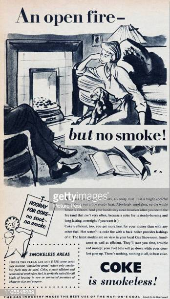 Couple relax next to a fire at home with the caption 'An open fire - but no smoke!' for an advertisement issued by the Gas Council for coke coal....