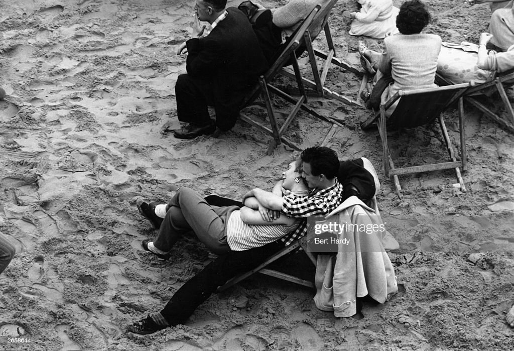 A couple relax on Blackpool beach. Original Publication: Picture Post - 8944 - Summer Holidays - Blackpool - unpub.
