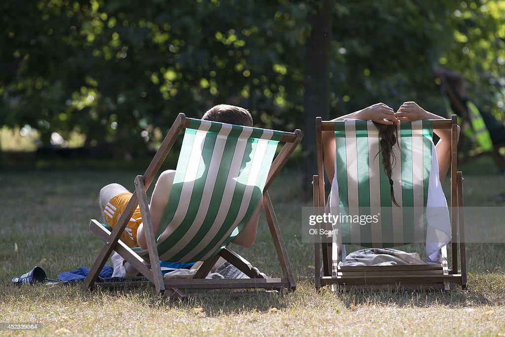A couple relax on deckchairs in the warm weather in Hyde Park on July 18, 2014 in London, England. The Met Office has issued a heatwave alert as temperatures soar to their highest of the year.