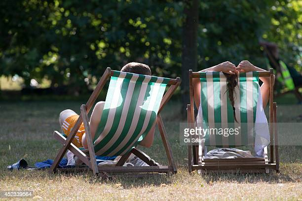 Couple relax on deckchairs in the warm weather in Hyde Park on July 18, 2014 in London, England. The Met Office has issued a heatwave alert as...