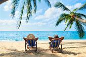 Couple relax on the beach enjoy beautiful sea on the tropical island