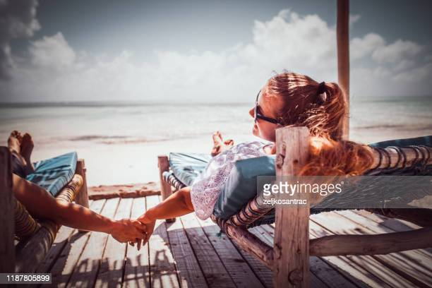 couple relax on the beach enjoy beautiful sea on the tropical island - honeymoon stock pictures, royalty-free photos & images