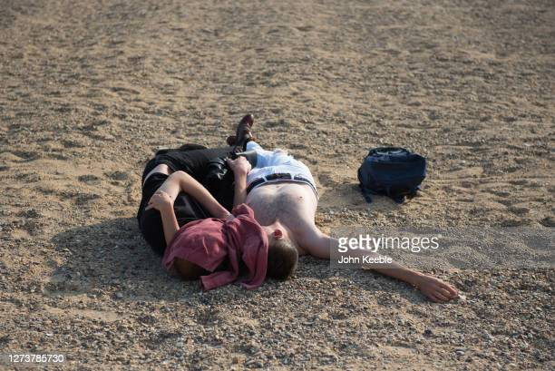 A couple relax on the beach in the late afternoon during the recent warm weather on September 20 2020 in Southend on Sea London