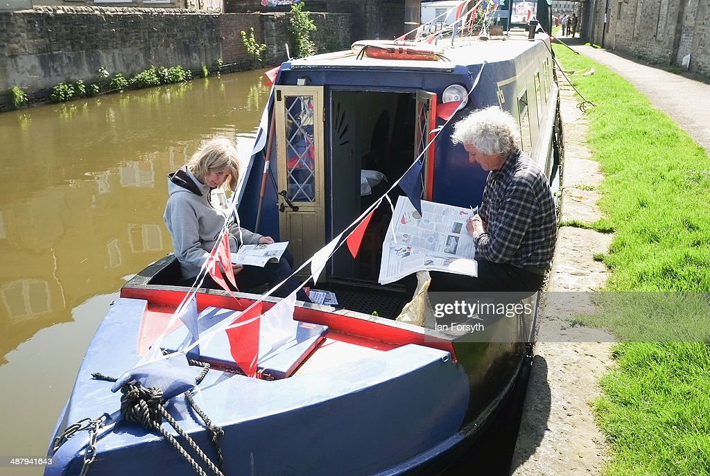 A couple relax with the morning papers during the Skipton Waterway Festival on May 3, 2014 in Skipton, England. The Waterway festival is a three day annual canal boat event held on the Leeds and Liverpool canal. The event brings together boaters and the local community who take part in the festival activities.