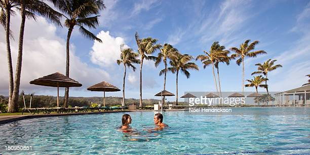 A couple relaxes in a pool