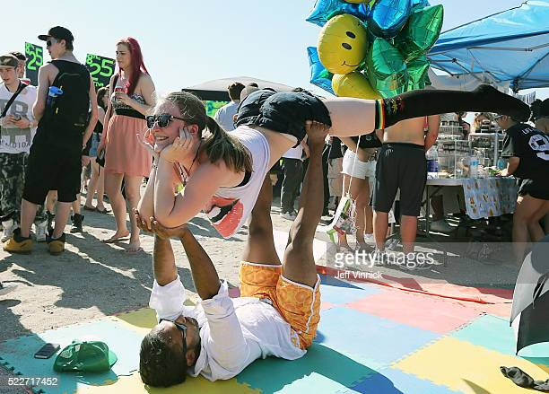A couple relaxes on Sunset Beach as thousands of people gathered at 4/20 celebrations on April 20 2016 at Sunset Beach in Vancouver Canada The...