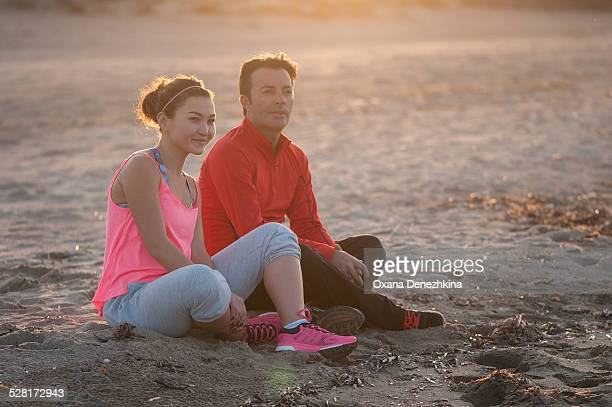 a couple relaxing after doing sport - after stock photos and pictures