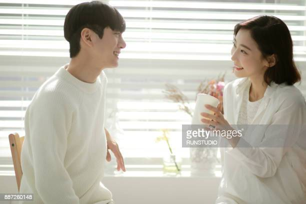 Couple relaxing and drinking coffee