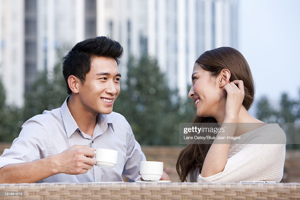 Couple Relaxing at a Cafe : Stock Photo