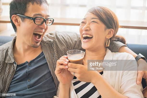 Couple relaxing at home on holiday