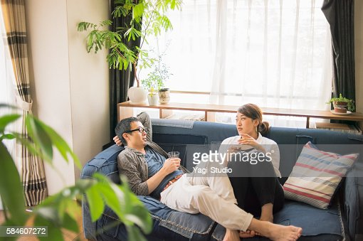 Couple Relaxing At Home On Holiday Stock Photo Getty Images