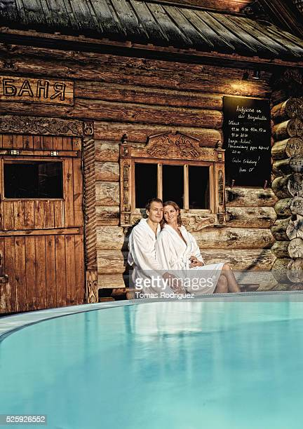 Couple relaxing at hot spring at night