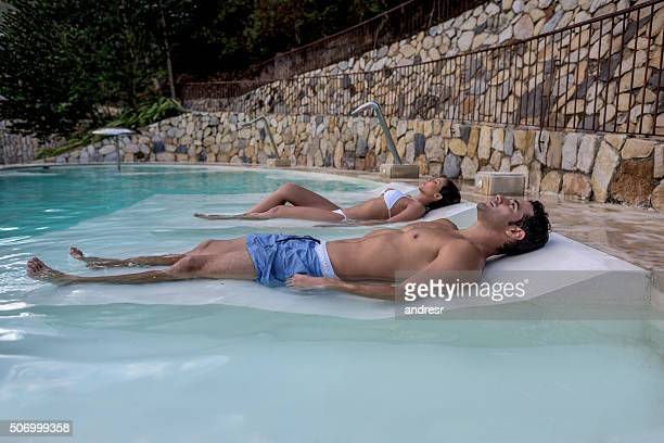 Couple relaxing at the spa in the pool
