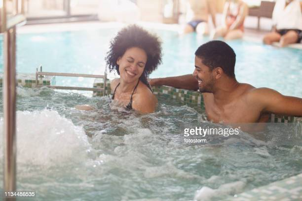 couple relaxing in a hot tub at spa - hot tub stock pictures, royalty-free photos & images