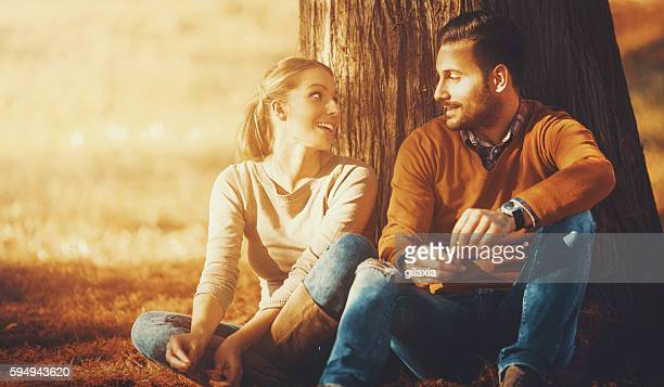 Couple relaxing in a park.