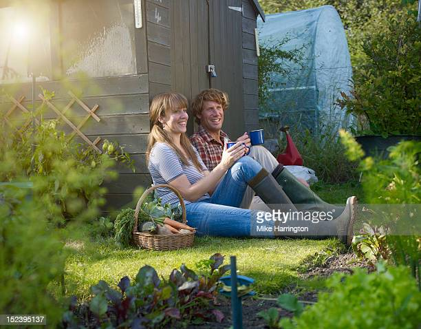 couple relaxing in allotment - vegetable garden stock pictures, royalty-free photos & images