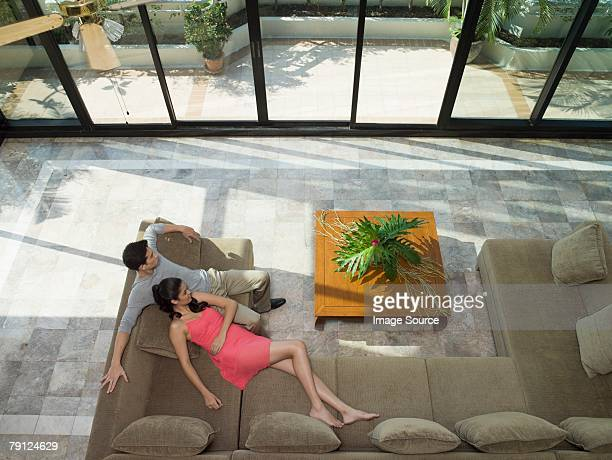 Couple relaxing in apartment