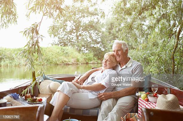 Couple relaxing in boat.