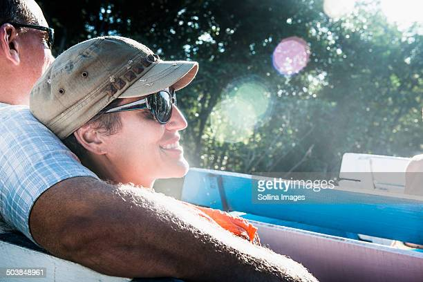 couple relaxing in boat - mid adult couple stock pictures, royalty-free photos & images