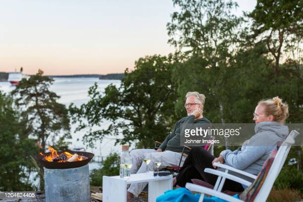 couple relaxing in garden - warming up stock pictures, royalty-free photos & images