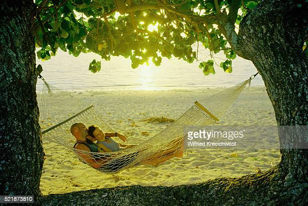 Couple Relaxing in Hammock at Sunset