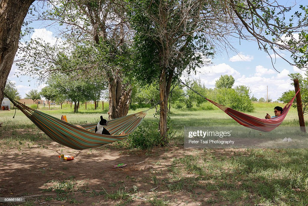 A couple relaxing in hammocks at the El Cosmico campsite in Marfa, Texas