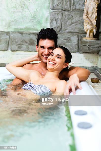 Couple relaxing in jacuzzi at spa center