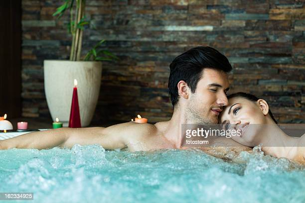 couple relaxing in hot tub - hot tub stock photos and pictures