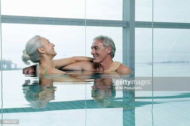 Couple relaxing in indoor pool