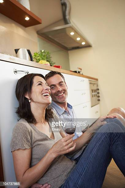 Couple relaxing in kitchen