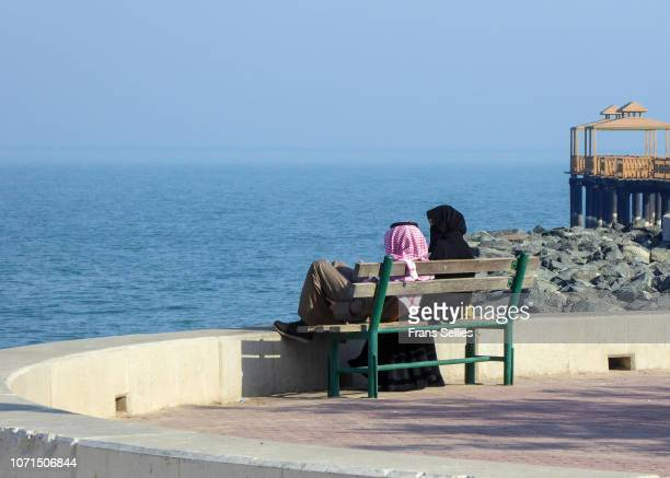 couple relaxing in kuwait city, kuwait - frans sellies stock pictures, royalty-free photos & images