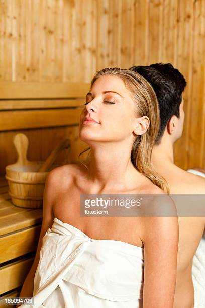 Couple relaxing in sauna