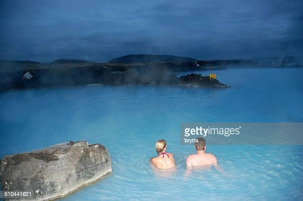 couple relaxing in the blue lagoon - blue lagoon iceland stock pictures, royalty-free photos & images