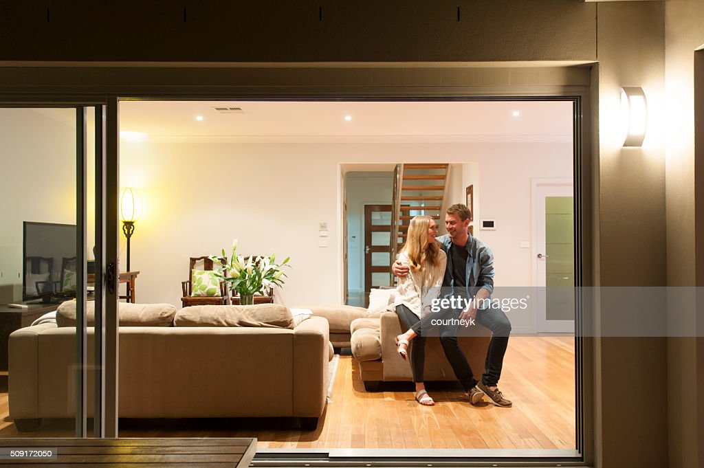Couple relaxing in their home at night. : Stock Photo