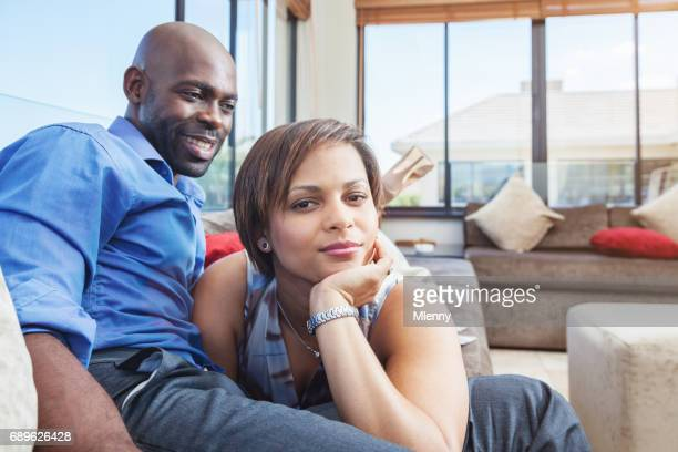 couple relaxing lazy at home in living room - mlenny stock pictures, royalty-free photos & images