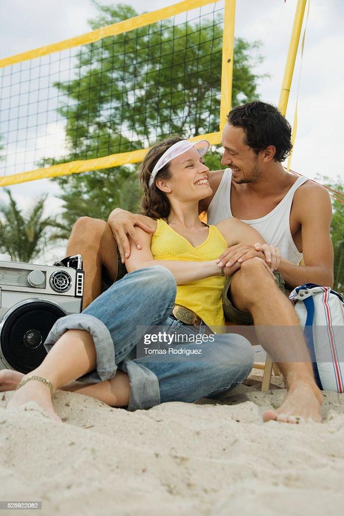Couple Relaxing on a Beach : Foto de stock