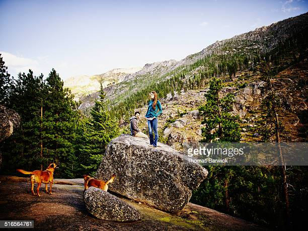 Couple relaxing on boulder at wilderness lookout