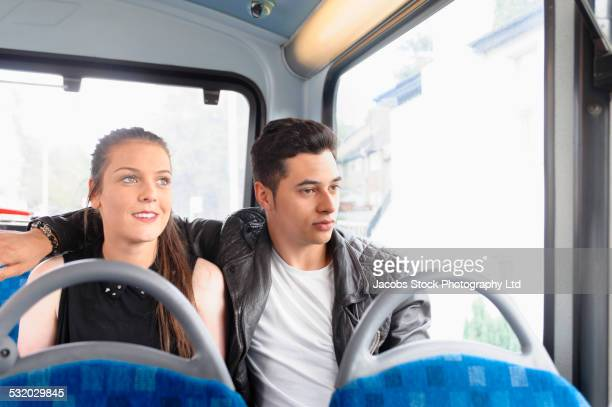 Couple relaxing on bus