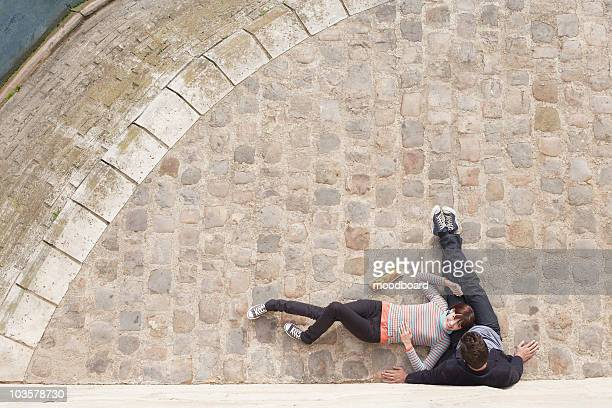 couple relaxing on cobble stones, view from above - unusual angle stock pictures, royalty-free photos & images