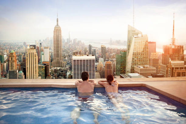 Couple relaxing on hotel rooftop