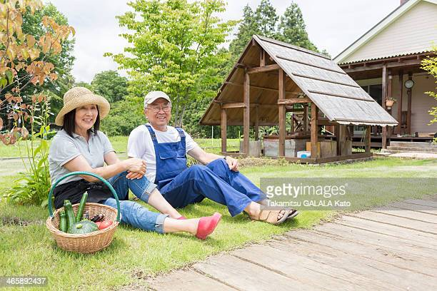 Couple relaxing on lawn
