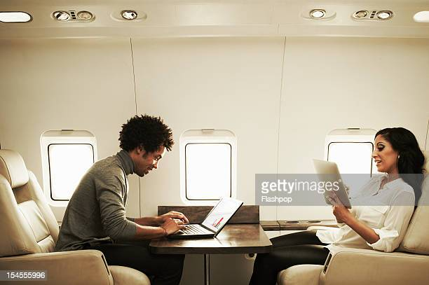 Couple relaxing on private jet